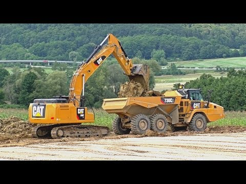 Excavator Cat 330F and dumpers Cat 730C2 work on highway - YouTube