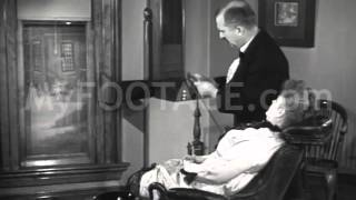 Stock Footage - 1800's Dentist Works on Female Patient