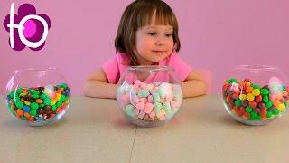Игрушки сюрпризы в разноцветных конфетах шариках Candy surprise toys m&m's skittles marshmello