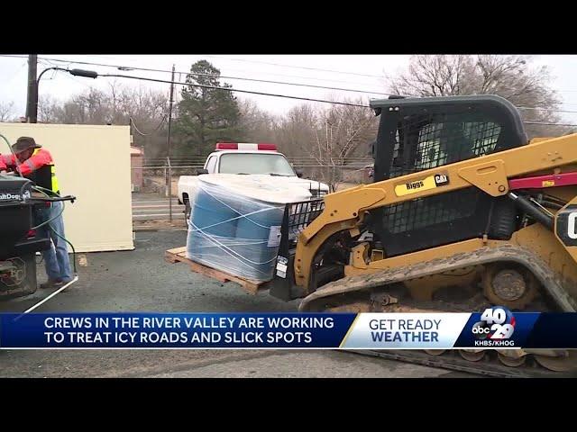 Sebastian County crews use runway deicer to treat trouble spots on roads