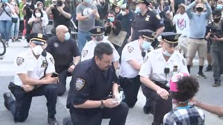 NYPD officers take a knee at lower Manhattan protest