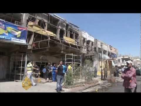 Series of bomb blasts kill scores in Baghdad