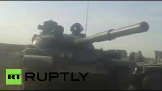 vuclip Inside Taliban-seized Kunduz: Tanks captured, prisoners freed, raising insurgent flag