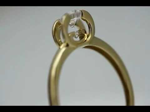 Уникальное золотое кольцо с фианитами. Голдиум