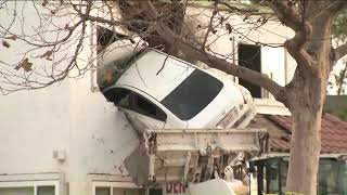 Car flies into building during crash