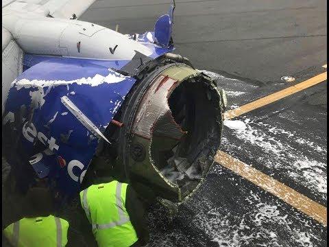 Airplane passenger pulled toward broken window damaged by blown engine mid-flight