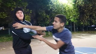 Fight breaks out in pickup basketball game! IRL KING OF THE HILL CHALLENGE! (GONE WRONG!)
