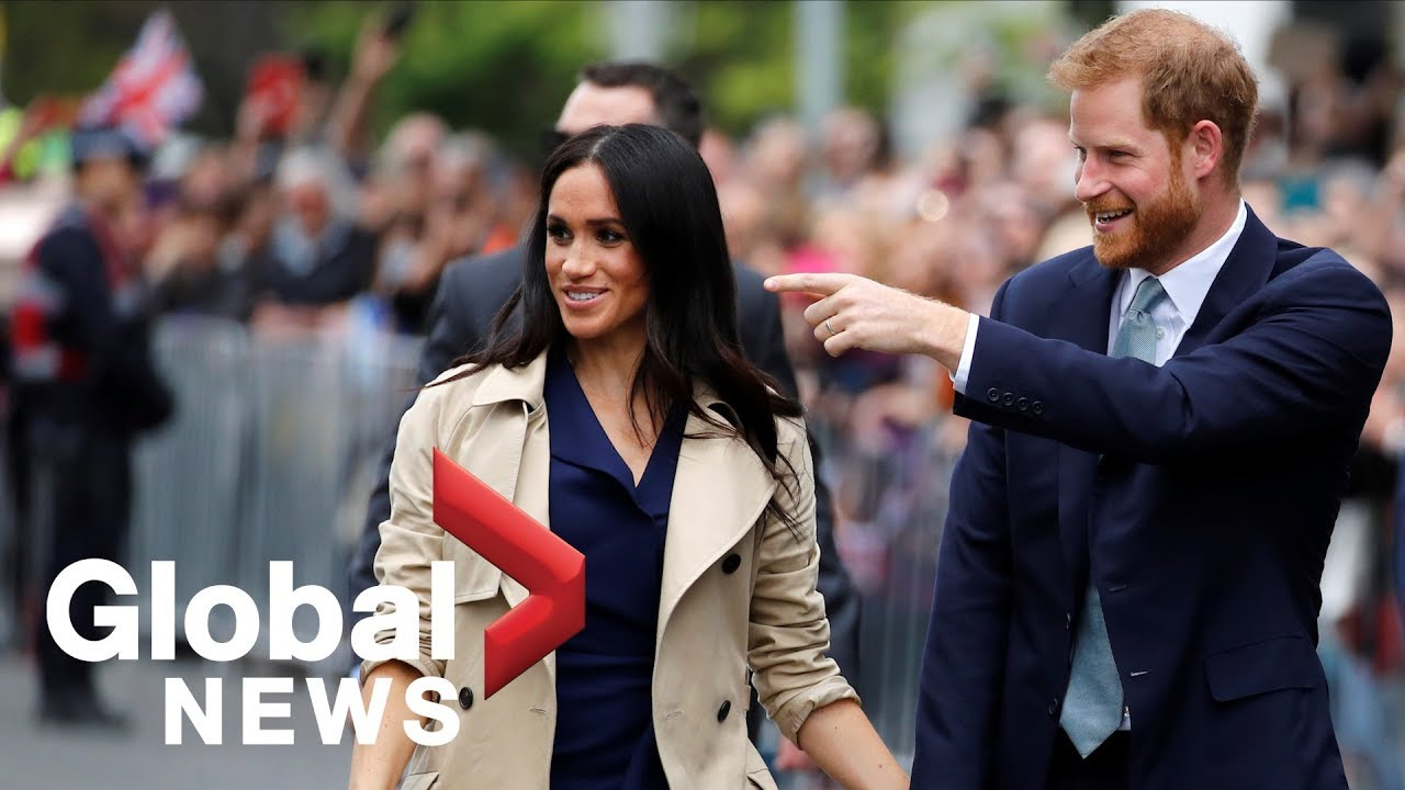 Prince Harry and Meghan Markle greeted by thousands in ...