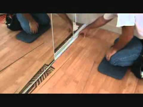 How to finish off a laminate planking floor edge next to for How to lay laminate flooring through a doorway