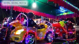 Naik  odong odong Motor di Pasar Malam