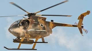 US Air Force instructors flying the MD 530F Military Helicopter