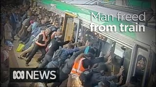 People power frees man trapped by Perth train..