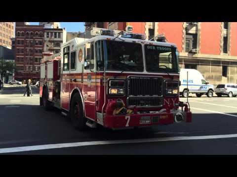 FDNY ENGINE 7 CRUISING BY ON NORTH MOORE STREET IN THE TRIBECA AREA OF MANHATTAN IN NEW YORK CITY.