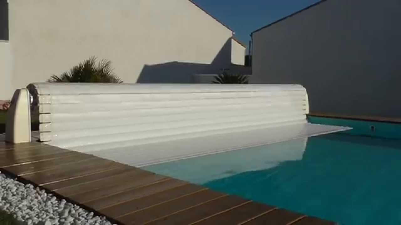 Volet hors sol motoris jupiter youtube for Volet piscine hors sol electrique
