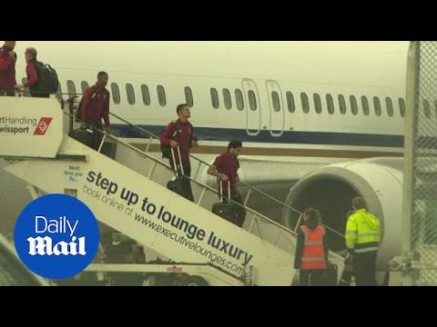 Liverpool's squad return home after Champions League final defeat - Daily Mail