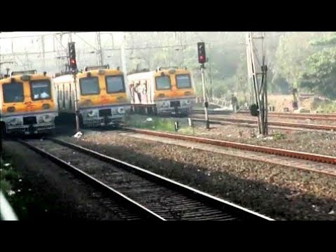 Mumbai local trains: one of the most Crowded railway in the world: Parallel journey
