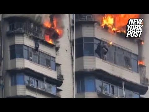 Daring man climbs out of a towering inferno 25 stories high | New York Post