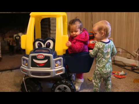 Levi and Aubree in a Cozy Truck