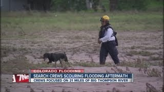 Search crews scouring flooded areas