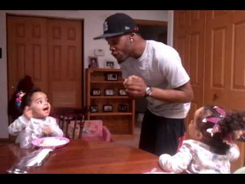 Twin girls arguing with their dad