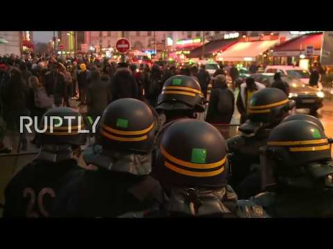 LIVE: Tensions flare during protest against police in Paris