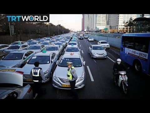 Taxi drivers in Seoul protest against carpooling service | Money Talks