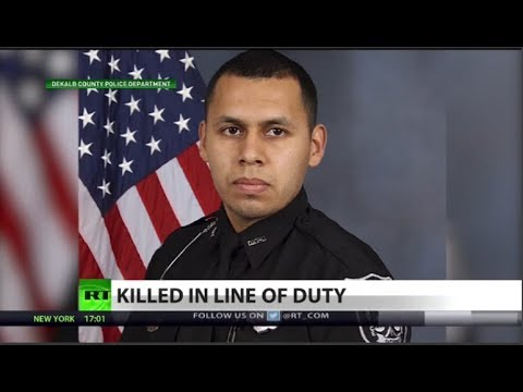 Dead police officer reveals America's race issue