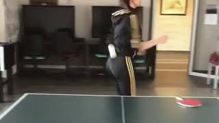 Girl Kicks Ping Pong Ball Across Table - 1025158