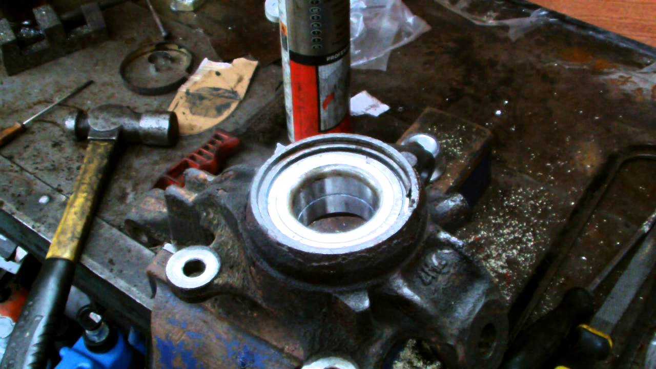 hight resolution of how to install a front wheel bearing on a nissan