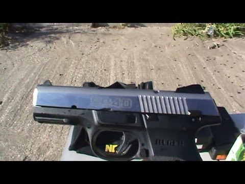 Ruger SR 40 .40S&W with stainless slide shooting at homemade green silhouette target