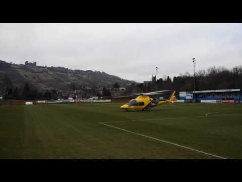 Helicopter taking off at the matlock vs Workington match air ambulance