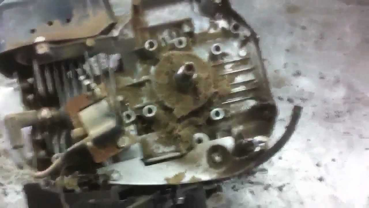 Lawn mower repair how to remove the flywheel on most small for Small electric motor repair