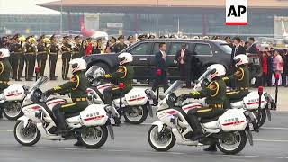 US President, First Lady arrive at Beijing airport