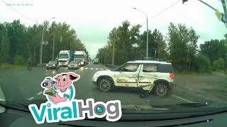 Armored Vehicle Hits Car in Intersection || ViralHog