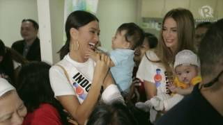 Miss Universe candidates play with Smile Train kids