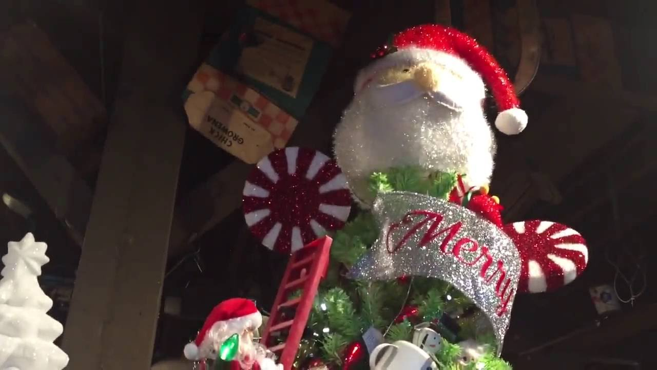 santa claus climbing ladder on christmas tree animated holiday decoration