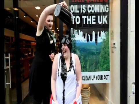Girl covered in oil in protest in Cheltenham .wmv