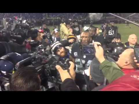 Charles Woodson Leads The Chant
