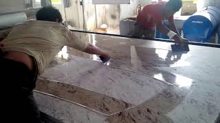 Applying epoxy - polymer to granite slab - India granite processing factory