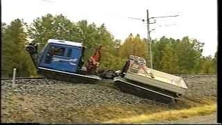 Tracked all terrain vehicle on railroad tracks.