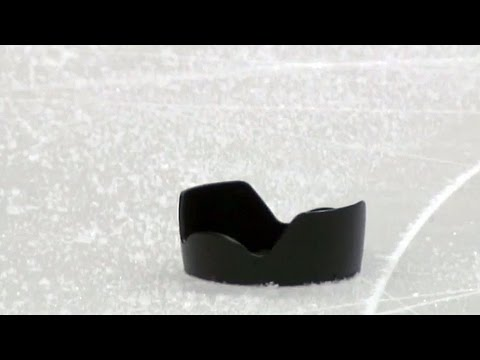 Cameraman has lens break after being hit by puck