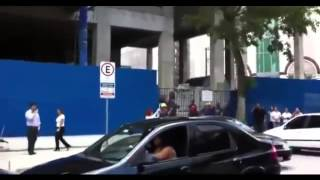 Brazilian woman destroys cheating husband's car in public