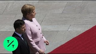 Angela Merkel OK After Visibly Shaking Next to Ukrainian President