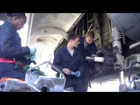 Airmen Repairing C-130 Hercules Cargo Aircraft