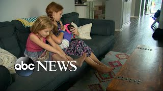2 young sisters react to their newly adopted baby sister
