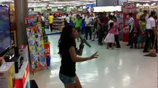 Random Girl (Zendee Rose Tenerefe) sings to the crowd of shoppers @ SM Megamall