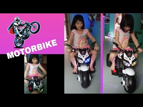 ELISHA RIDES ON MOTORBIKE TOYS