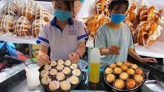 Hai nữ sinh làm bánh Bạch tuộc Takoyaki điêu luyện đơn giản tròn như bóng Golf ở đường phố Sài Gòn