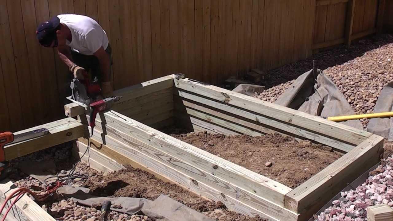 Building a raised vegetable garden planter landscape for Builders to build a house