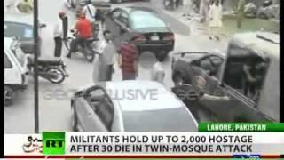 Gunmen hold hundreds hostage, kill dozens in mosque attacks in Lahore, Pakistan.flv